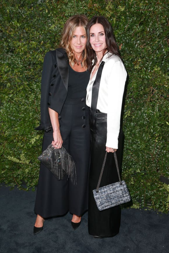 Jennifer Aniston and Courtney Cox at the CHANEL Dinner celebrating the Our Majestic Oceans Benefit.