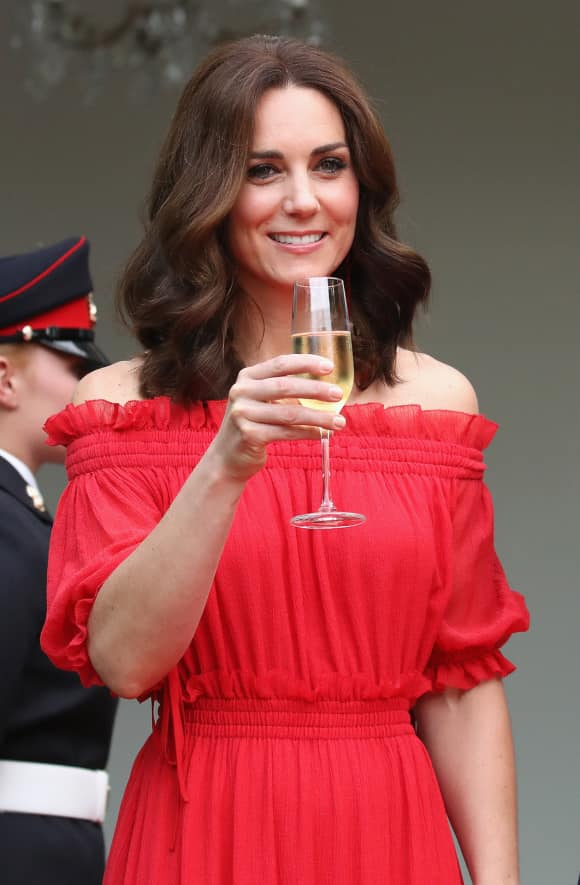 Duchess Kate showing off her stunning red dress
