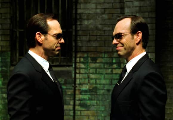 "Hugo Weaving playing the role of ""Agent Smith"" in ""The Matrix"""