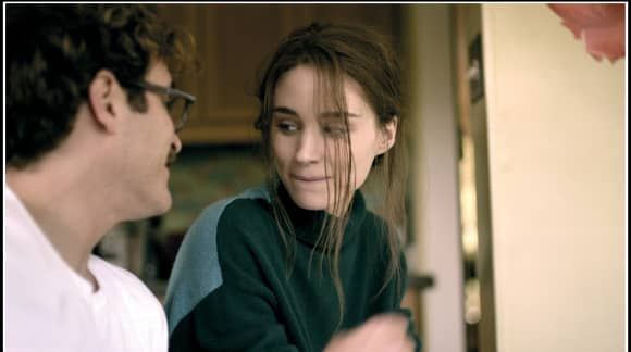 Joaquin Phoenix and Rooney Mara appear in the film Her in 2013.