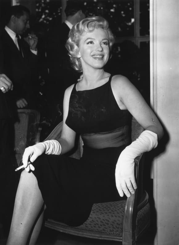 American film actress Marilyn Monroe (1926-1962) at a Press Conference at the Savoy Hotel in London to publicize her forthcoming film, 'The Prince and the Showgirl'