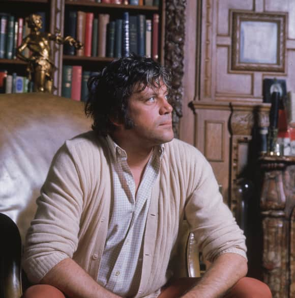 Oliver Reed at his house in Surrey