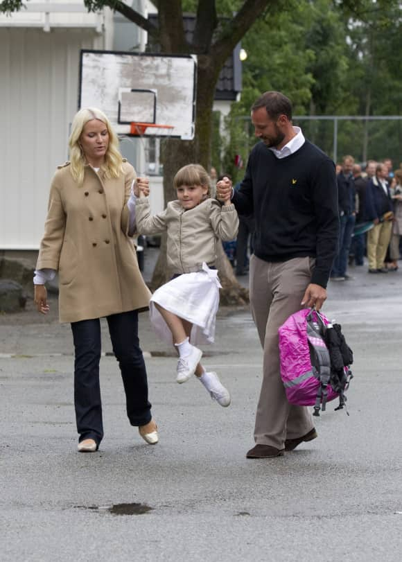 Princess Ingrid with her parents on her first day of school