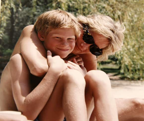 Prince Harry and Princess Diana during a family vacation