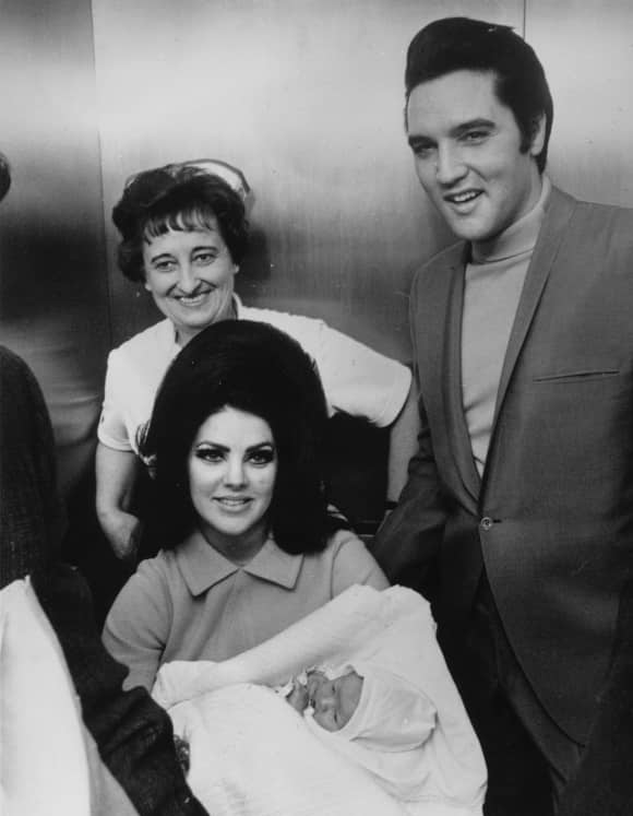 Priscilla and Elvis Presley shortly after the birth of their daughter Lisa Marie