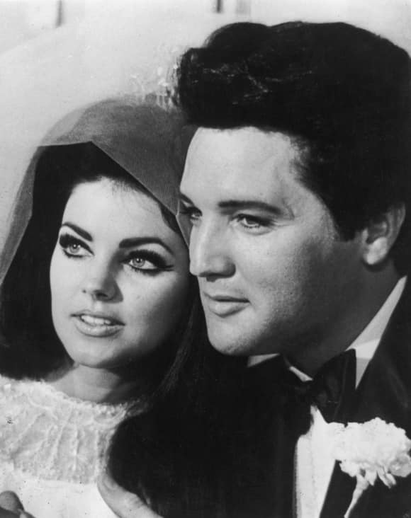 Priscilla and Elvis Presley at their wedding in 1967