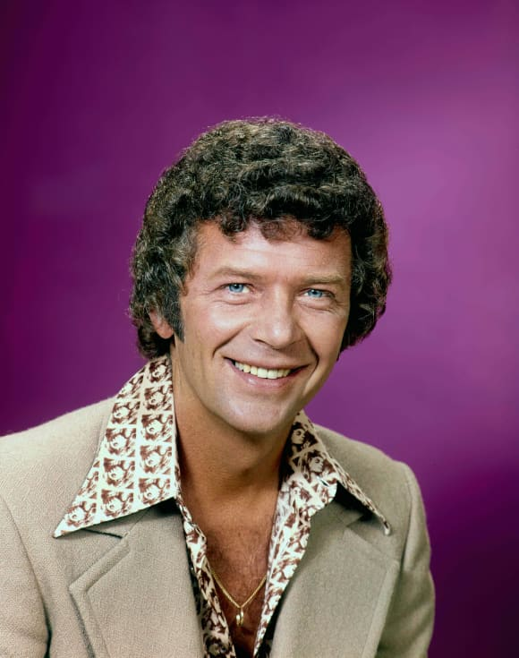 "Robert Reed as ""Mike Brady"""
