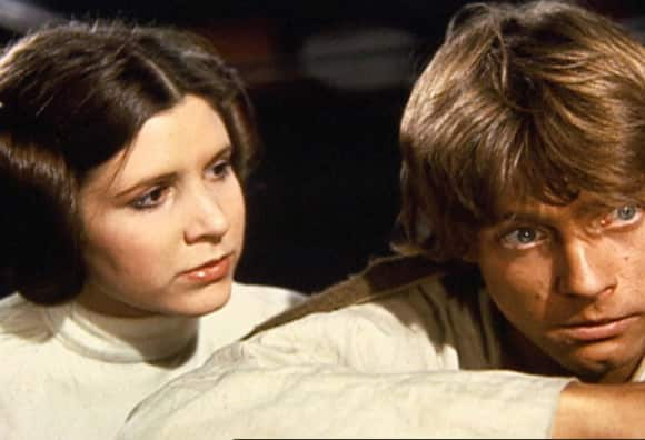 "Carrie Fisher as ""Princess Leia"" with ""Luke Skywalker"", played by Mark Hamill in A New Hope 1977"
