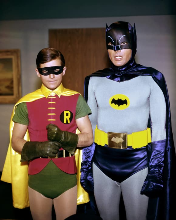 """Adam West and Burt Ward as """"Batman"""" and """"Robin"""" in the 1960's."""