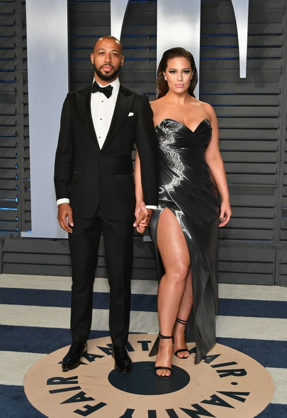 Justin Ervin and Ashley Graham attend the 2018 Vanity Fair Oscar Party on March 4, 2018