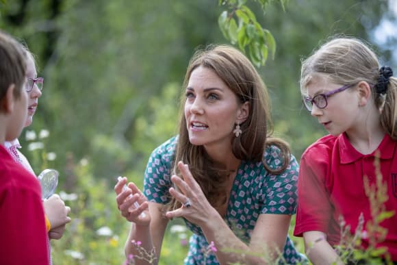 The Duchess of Cambridge with children from her patronages at the Royal Hampton Court Flower Festival.