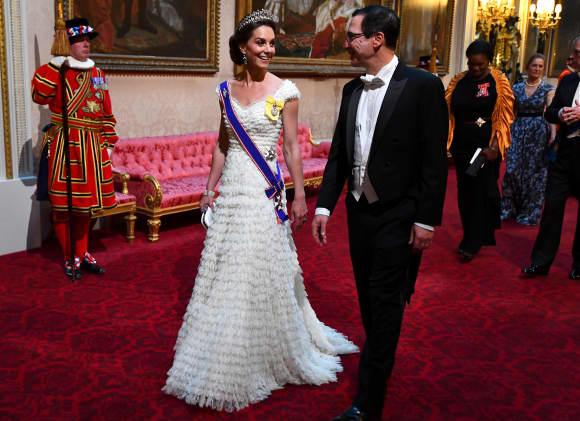 Duchess Catherine and US Secretary of Treasury Steven Mnuchin arrive for the State Banquet at Buckingham Palace.