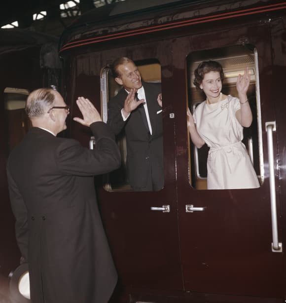 Queen Elizabeth II and Prince Philip leave Manchester by train in May 1961