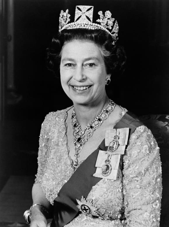 Official portrait released in June 1987 and taken at Buckingham Palace shows Queen Elizabeth II, wearing a gold lame gown with an early 19th Century diadem made for George IV.